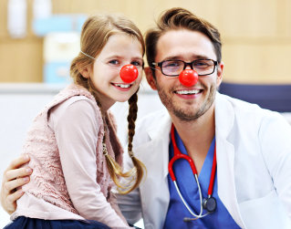 male doctor and a child smiling