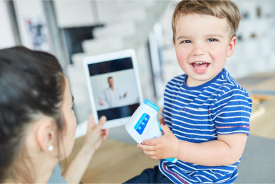 Laughing child with clinical thermometer