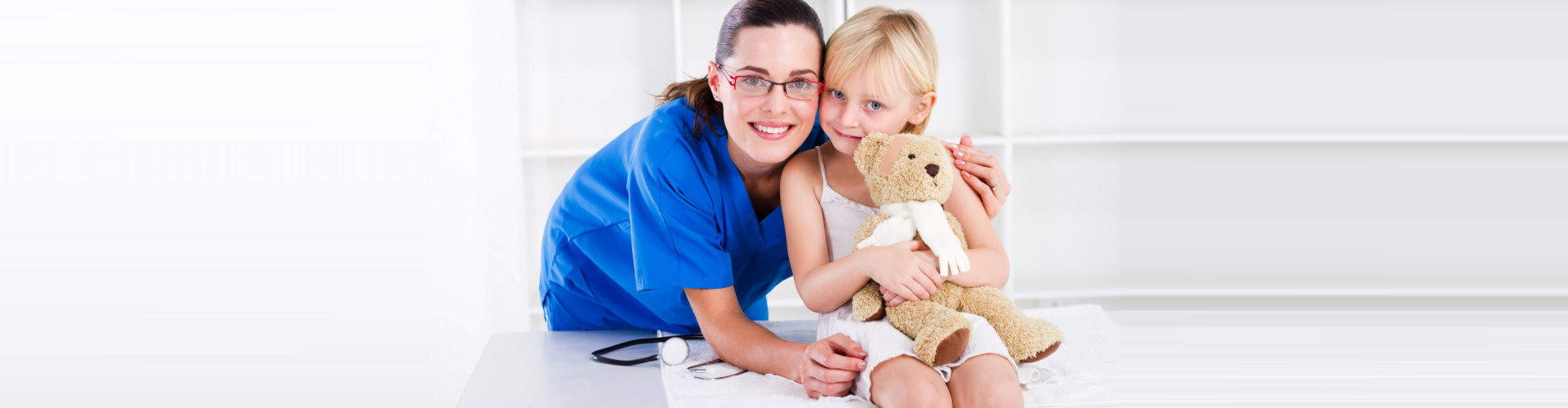 nurse and a kid smiling