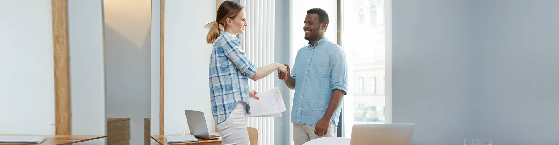 an applicant and an employer shaking hands